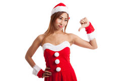 Asian Christmas girl with Santa Claus clothes thumbs down Stock Photography