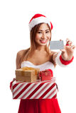 Asian Christmas girl with Santa clothes,  gift box and card Stock Image