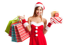 Asian Christmas girl with Santa clothes,  gift box and shopping Stock Image