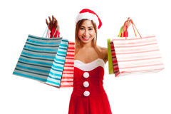 Asian Christmas girl with Santa clothes and shopping bag Royalty Free Stock Photography