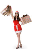 Asian Christmas girl. Shopping and holding bags, full length portrait on white background Royalty Free Stock Photo