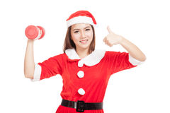 Asian Christmas girl thumbs up with Santa Claus clothes and red Stock Photography