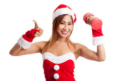 Asian Christmas girl thumbs up with Santa Claus clothes and red Stock Photo