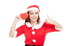 Asian Christmas girl thumbs up with Santa Claus clothes with red Royalty Free Stock Photo