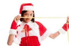 Asian Christmas Santa Claus girl Asian Christmas girl in Santa C royalty free stock image