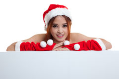 Asian Christmas Santa Claus girl with blank sign. Royalty Free Stock Image
