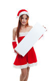 Asian Christmas Santa Claus girl with blank sign. Royalty Free Stock Photography