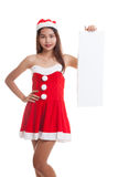 Asian Christmas Santa Claus girl with blank sign. Stock Photography