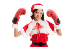Asian Christmas Santa Claus girl  with boxing glove. Isolated on white background Royalty Free Stock Photo