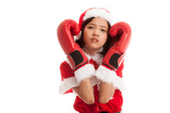 Asian Christmas Santa Claus girl  with boxing glove. Isolated on white background Stock Photo