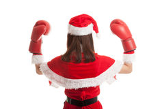 Asian Christmas Santa Claus girl  with boxing glove. Asian Christmas Santa Claus girl  with boxing glove  isolated on white background Royalty Free Stock Photos