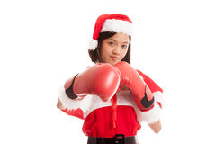 Asian Christmas Santa Claus girl  with boxing glove. Isolated on white background Royalty Free Stock Images