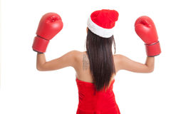 Asian Christmas Santa Claus girl  with boxing glove. Asian Christmas Santa Claus girl  with boxing glove  isolated on white background Royalty Free Stock Photo