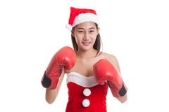 Asian Christmas Santa Claus girl  with boxing glove. Asian Christmas Santa Claus girl with boxing glove  isolated on white background Stock Photography
