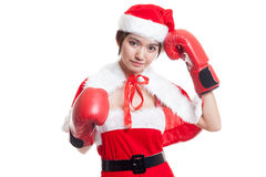 Asian Christmas Santa Claus girl  with boxing glove. Asian Christmas Santa Claus girl  with boxing glove  isolated on white background Stock Image
