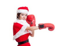 Asian Christmas Santa Claus girl  with boxing glove. Asian Christmas Santa Claus girl  with boxing glove  isolated on white background Royalty Free Stock Images