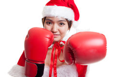 Asian Christmas Santa Claus girl  with boxing glove. Asian Christmas Santa Claus girl  with boxing glove  isolated on white background Stock Photo