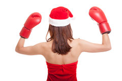 Asian Christmas Santa Claus girl  with boxing glove. Asian Christmas Santa Claus girl  with boxing glove  isolated on white background Royalty Free Stock Photography