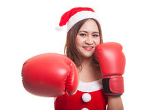 Asian Christmas Santa Claus girl  with boxing glove. Asian Christmas Santa Claus girl  with boxing glove  isolated on white background Stock Photos