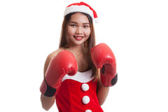 Asian Christmas Santa Claus girl  with boxing glove. Royalty Free Stock Photography