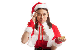 Asian Christmas Santa Claus girl diet with measuring tape. stock photography