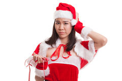 Asian Christmas Santa Claus girl diet with  measuring tape. Asian Christmas Santa Claus girl diet with  measuring tape  isolated on white background Stock Image