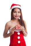 Asian Christmas Santa Claus girl and  gift box. Royalty Free Stock Images