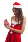 Asian Christmas Santa Claus girl and  gift box. Royalty Free Stock Photos