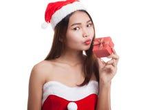 Asian Christmas Santa Claus girl  kiss a  gift box. Stock Photos