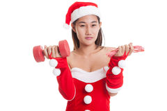 Asian Christmas Santa Claus girl with measuring tape and dumbbel Royalty Free Stock Photos