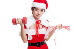 Asian Christmas Santa Claus girl with measuring tape and dumbbel Stock Photo
