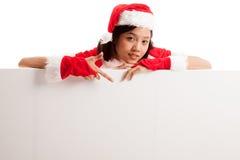 Asian Christmas Santa Claus Girl Point Down To Blank Sign Stock Photos