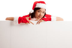 Asian Christmas Santa Claus girl  point down to blank sign Stock Photos