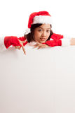 Asian Christmas Santa Claus girl  point down to blank sign Royalty Free Stock Photos
