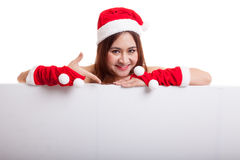 Asian Christmas Santa Claus girl  point down to blank sign. Stock Photos