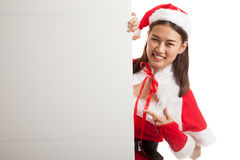 Asian Christmas Santa Claus girl point to blank sign. Royalty Free Stock Photography