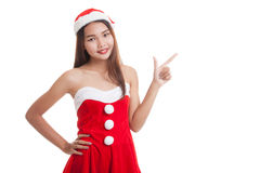 Asian Christmas Santa Claus girl  point to blank space. Royalty Free Stock Image