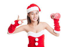 Asian Christmas Santa Claus girl  point to red dumbbell. Asian Christmas Santa Claus girl  point to red dumbbell  isolated on white background Stock Image
