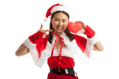 Asian Christmas Santa Claus girl  point to red heart. Asian Christmas Santa Claus girl point to red heart  isolated on white background Royalty Free Stock Photography
