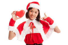Asian Christmas Santa Claus girl point to red heart stock image