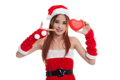 Asian Christmas Santa Claus girl  point to red heart. Asian Christmas Santa Claus girl point to red heart  isolated on white background Royalty Free Stock Photo