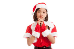 Asian Christmas Santa Claus girl  is praying. Isolated on white background Royalty Free Stock Photo