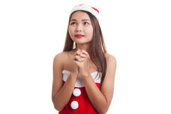 Asian Christmas Santa Claus girl  is praying. Royalty Free Stock Photography