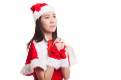 Asian Christmas Santa Claus girl  is praying. Stock Photography