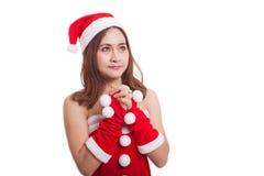 Asian Christmas Santa Claus girl  is praying. Stock Images