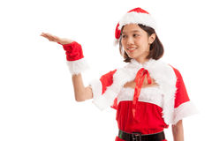 Asian Christmas Santa Claus girl  present space on her hand Royalty Free Stock Images