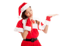 Asian Christmas Santa Claus girl  present space on her hand Royalty Free Stock Photography