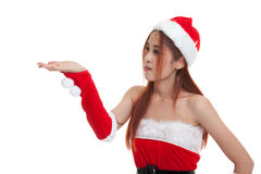 Asian Christmas Santa Claus girl  present space on her hand. Stock Image