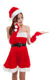 Asian Christmas Santa Claus girl  present space on her hand. Stock Photo