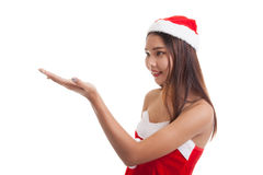 Asian Christmas Santa Claus girl  present space on her hand. Stock Photography